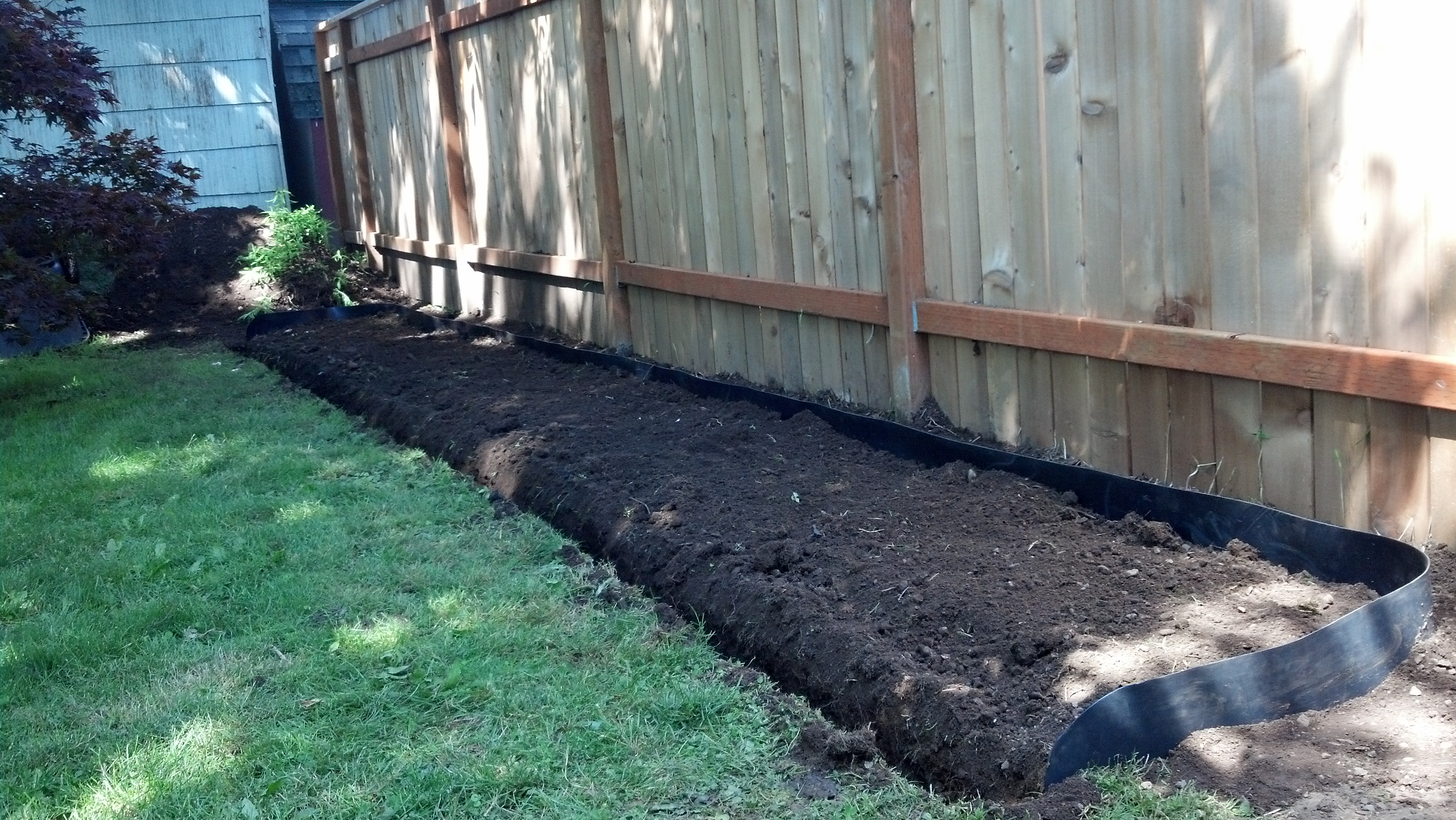 Three sided barrier with pruning trench in front.